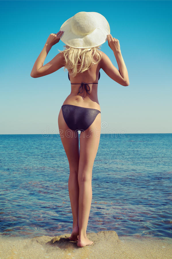 Back of a woman at the sea stock images