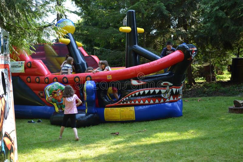 Back yard bouncy castle royalty free stock image
