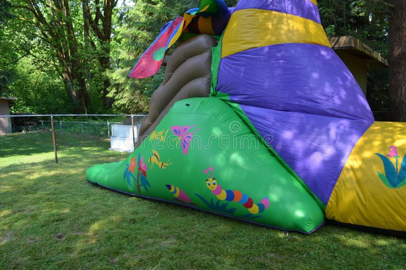 Back yard carnival. Bouncy castle. Outdoor private back yard carnival with clowns, bouncy castles, face painters and games and balloons stock images