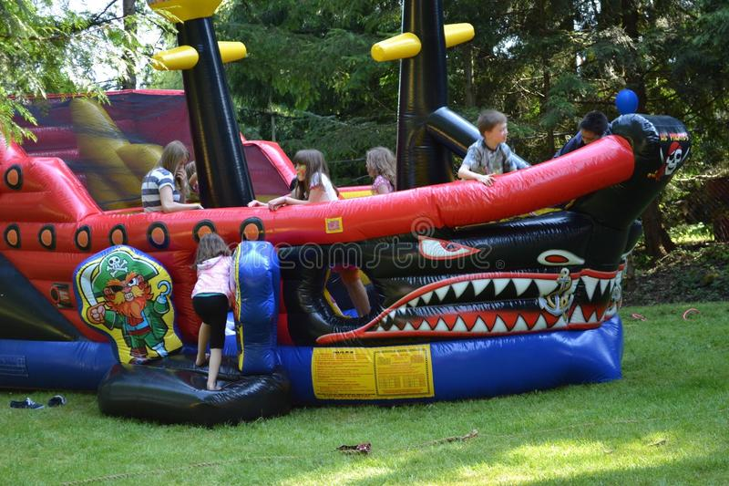 Back yard carnival. Bouncy castle. Outdoor private back yard carnival with clowns, bouncy castles, face painters and games and balloons stock photos