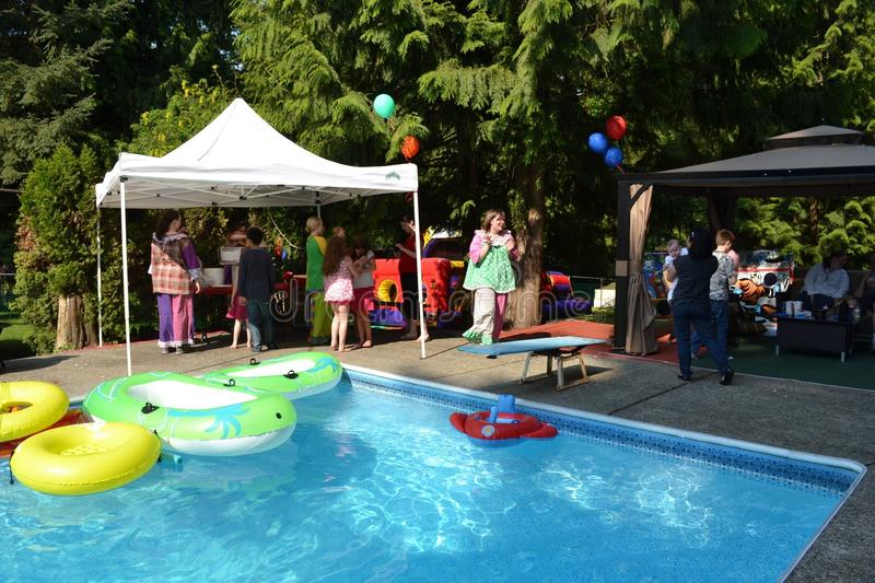 Back yard carnival. Bouncy castle. Outdoor private back yard carnival with clowns, bouncy castles, face painters and games and balloons royalty free stock image