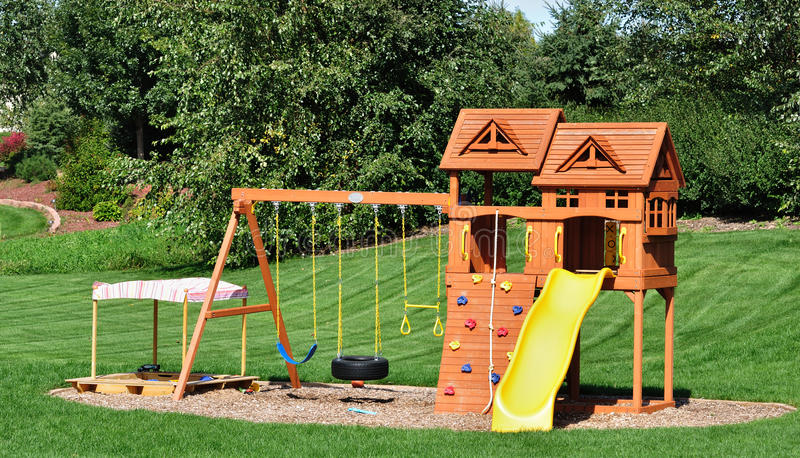 Download Back Yard Wooden Swing Set stock photo. Image of sunny - 16431252