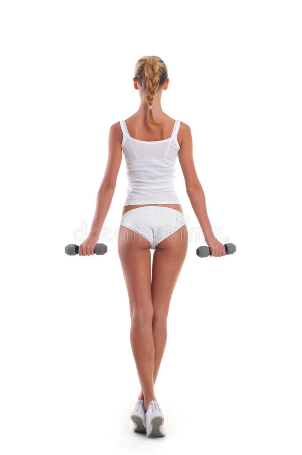 Download Back Of A Young And Fit Woman Holding Dumbbells Stock Image - Image: 29535227