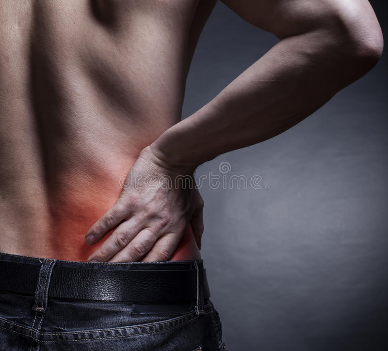 Backache. Pain in the lower back. Man's back royalty free stock images