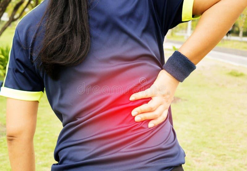 Backache on womon`s back stock photos