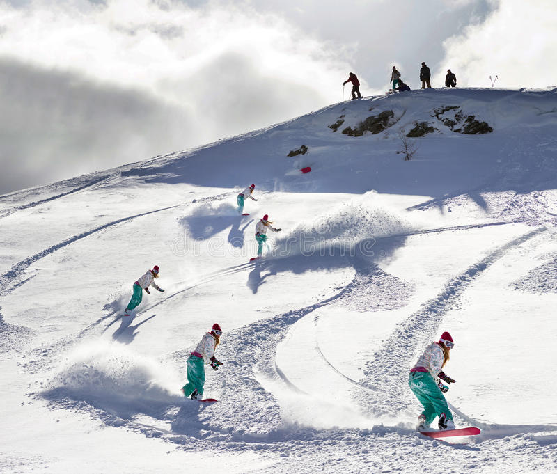 Backcountry sequence. Female snowboarder freeriding in the backcountry stock images