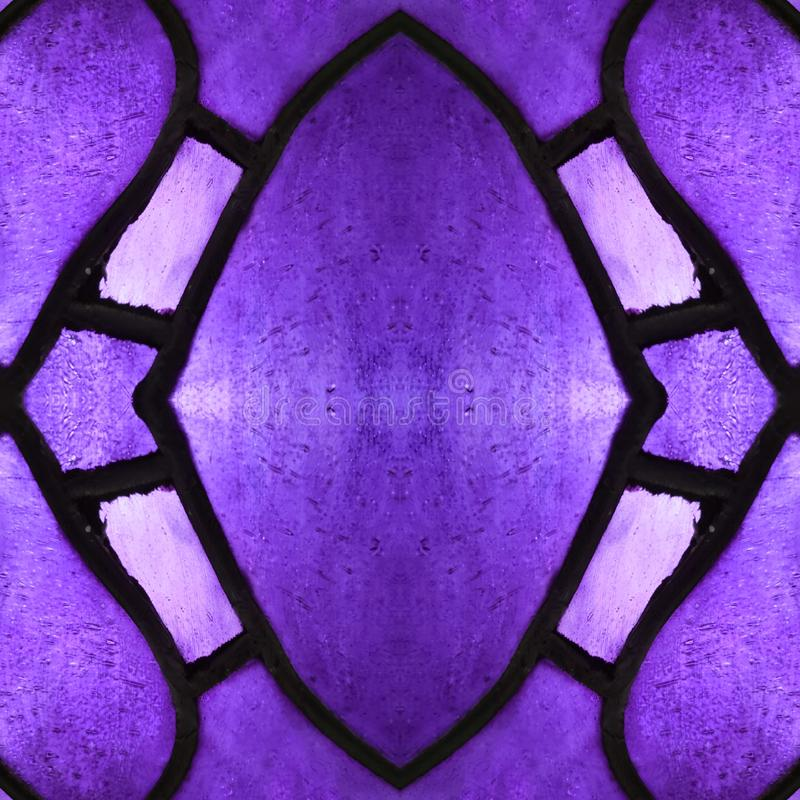 approaching the stained glass in purple colors, with symmetry and reflection effect, background and texture stock photo