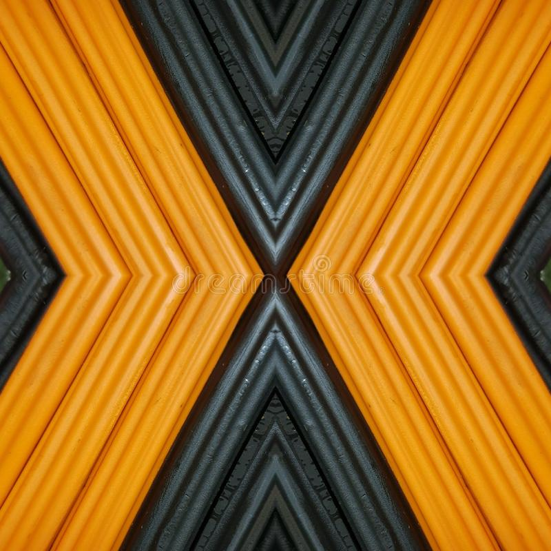 Abstract design with pieces of plasticine bars in colors orange and black, background and texture. Backdrop for color-related announcements, school material for royalty free stock photos