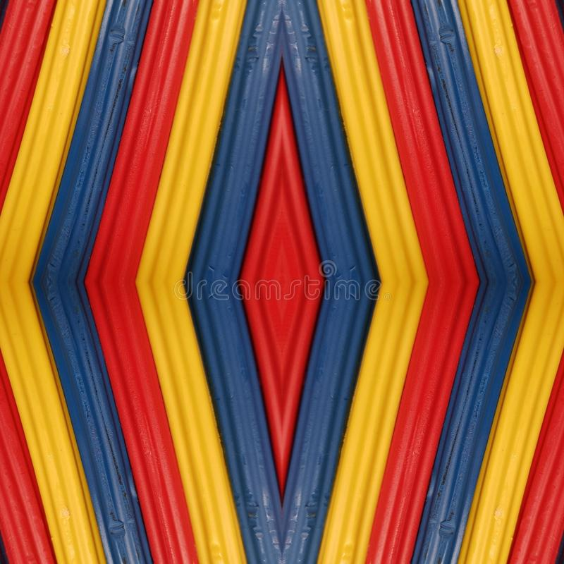 Abstract design with pieces of plasticine bars in colors red, yellow and blue, background and texture. Backdrop for color-related announcements, school material stock image