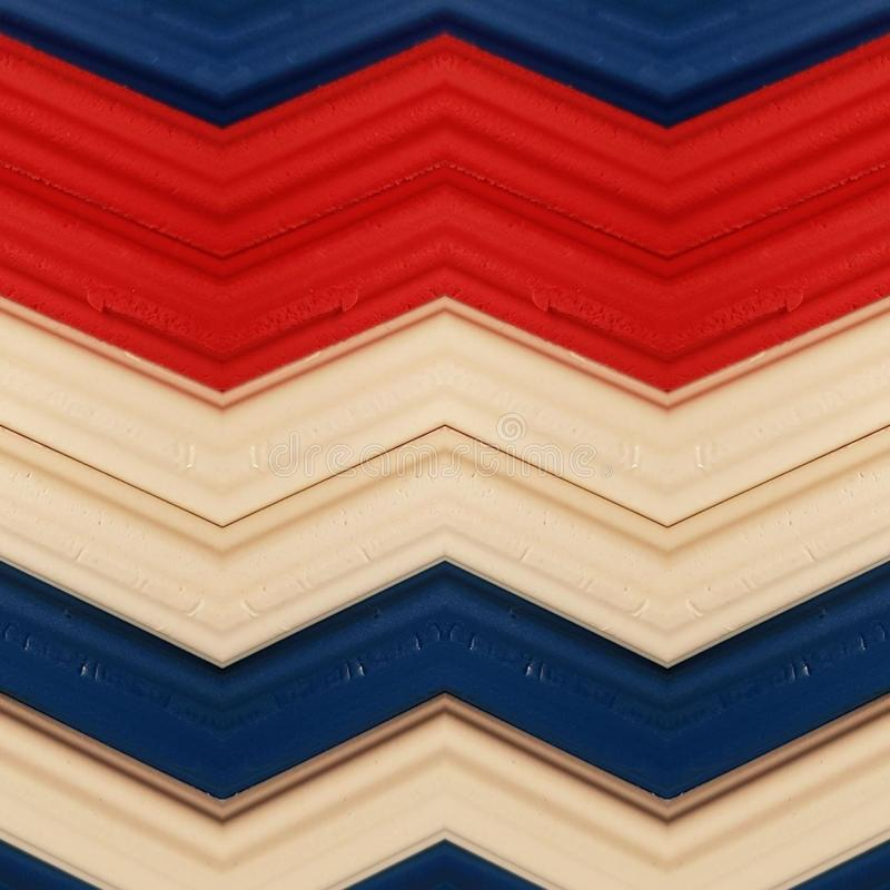 Abstract design with pieces of plasticine bars in colors red, white and blue, background and texture. Backdrop for color-related announcements, school material royalty free stock photography