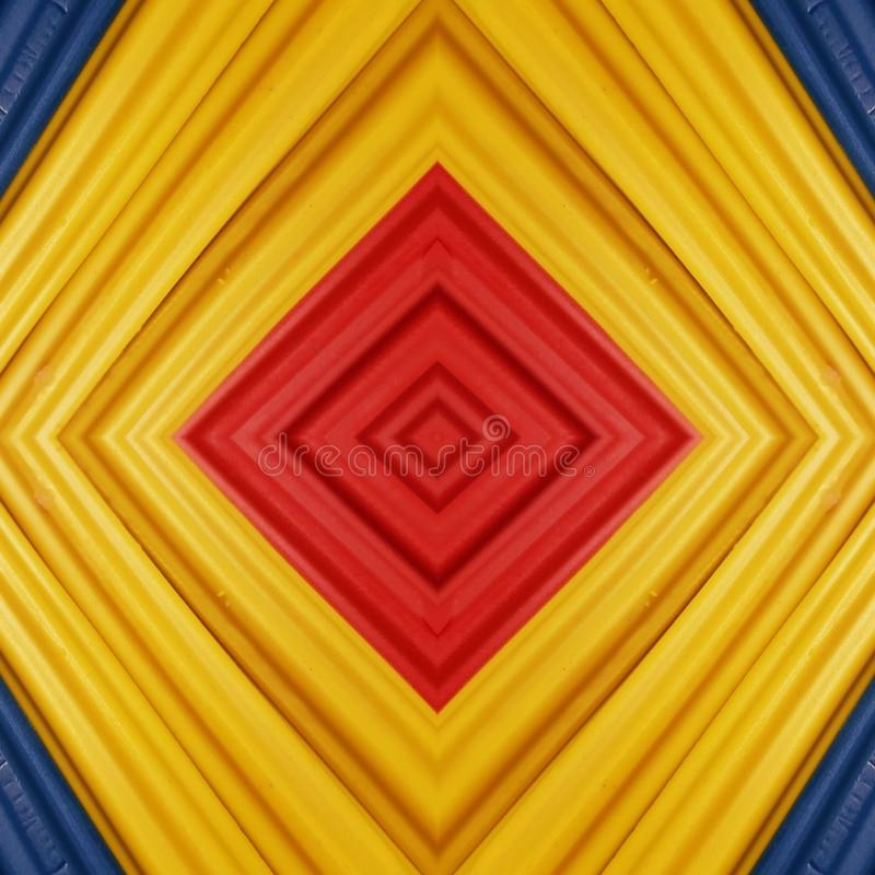 Abstract design with pieces of plasticine bars in colors yellow, blue and red, background and texture. Backdrop for color-related announcements, school material royalty free stock image