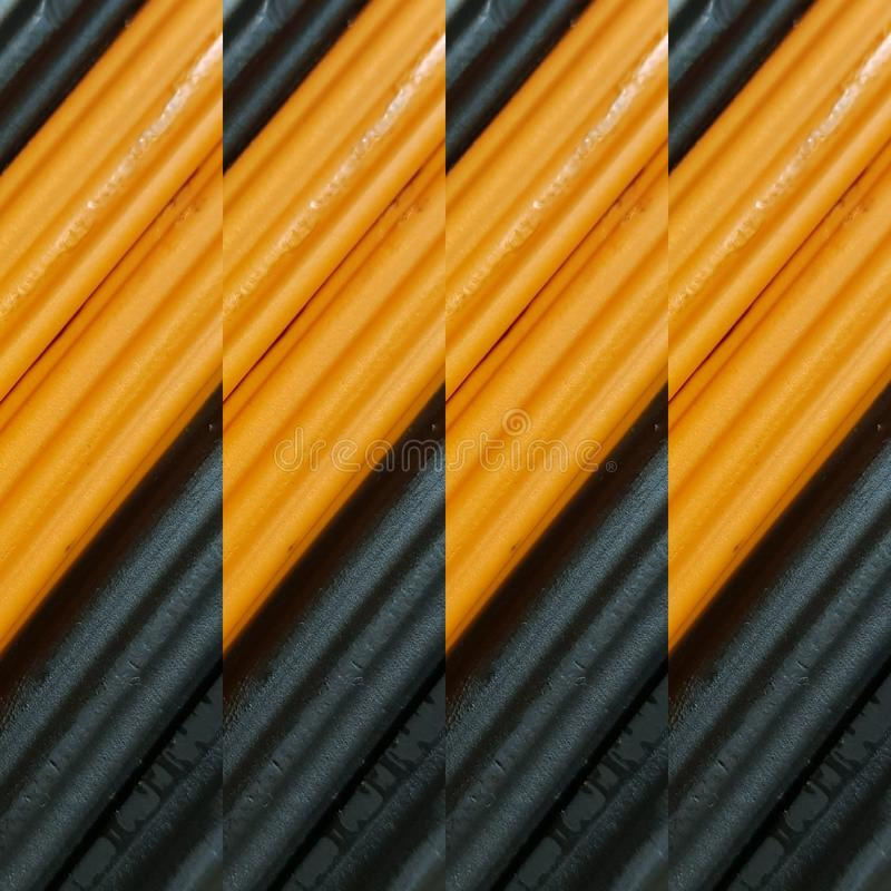 Abstract design with pieces of plasticine bars in colors orange and black, background and texture. Backdrop for color-related announcements, school material for royalty free stock photography
