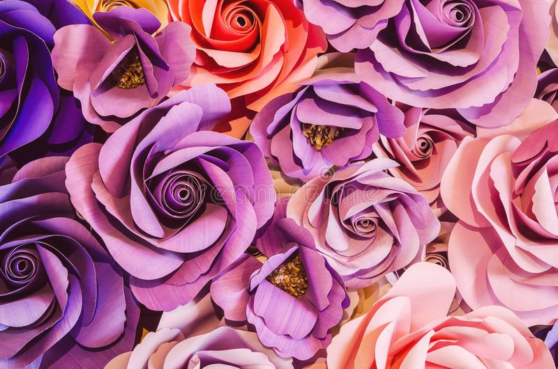 Backdrop of colorful paper roses background in a wedding. stock images