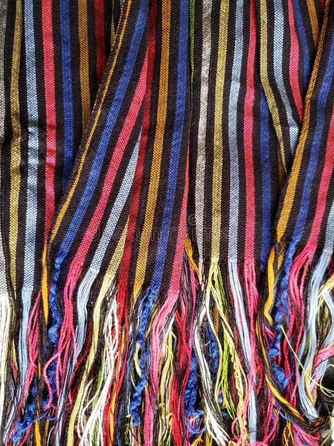 approach to a multicolored mexican rebozo with stripes, background and texture royalty free stock images