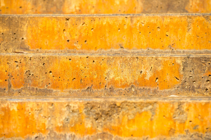 Backdrop rustic colored stairs outdoor. Close up rustic orange colored limestone or concrete stairs outdoor with abstract pattern and texture, copy space stock photos
