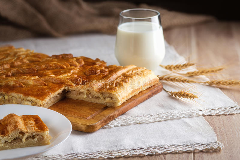 Backed pie and glass of milk stock photos