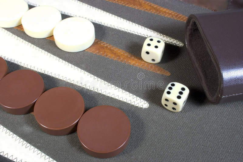 Backgammon. A backgammon game board with dice and playing pieces stock photography
