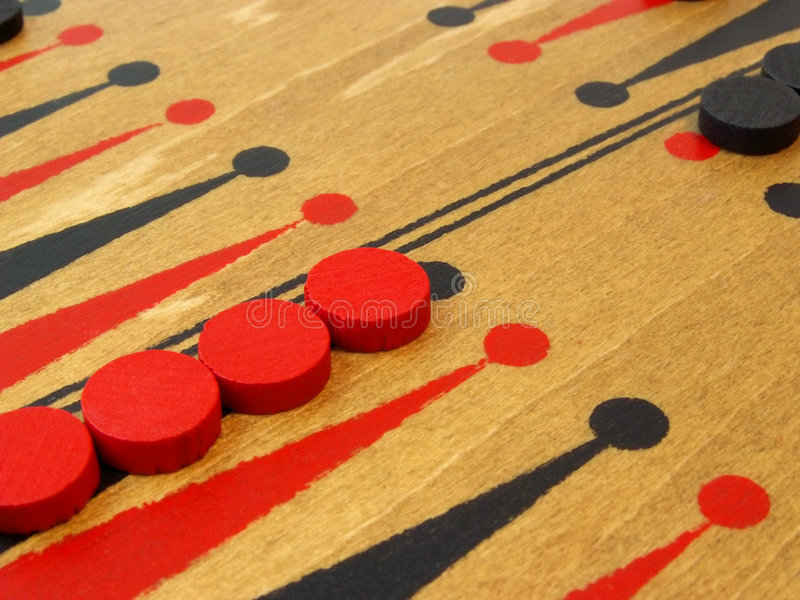 Backgammon game board and pieces stock image