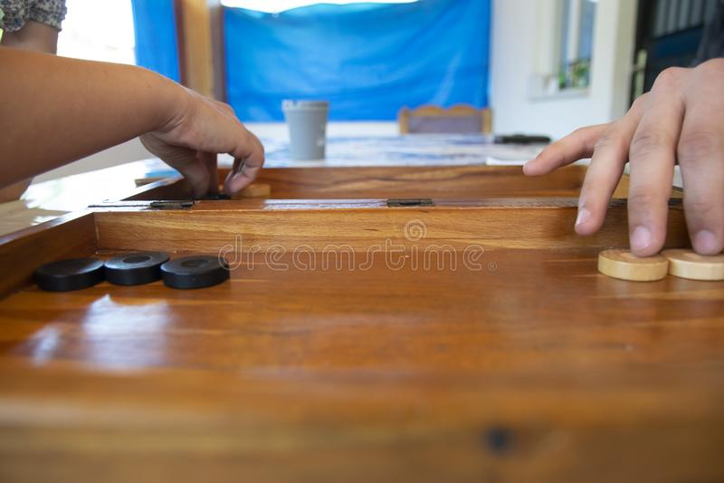 Backgammon game. The player`s hand moves the chip, closeup.  royalty free stock photo