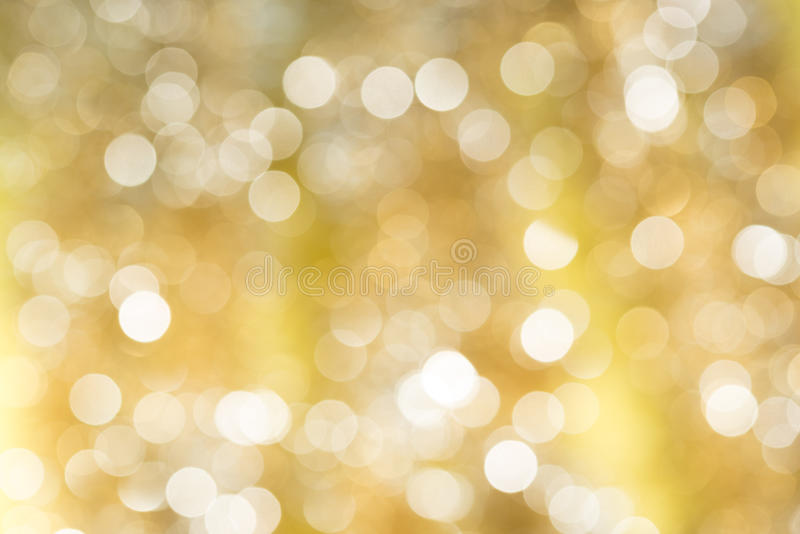 Backgound abstrait de lumière de bokeh brouillé par or photos stock