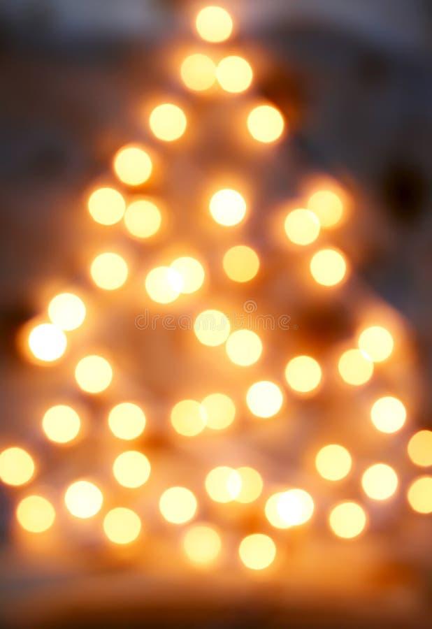 Backgrou da luz de Natal do ouro imagem de stock
