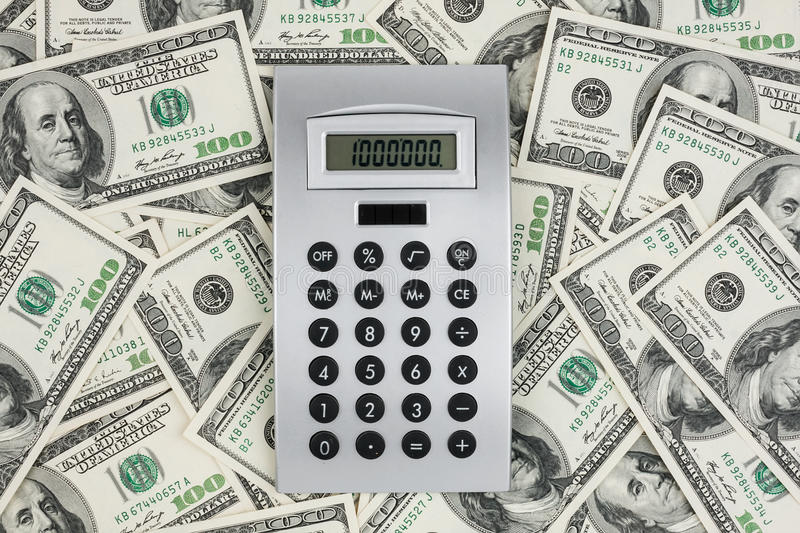 Download Background Of $ 100 Bills And A Calculator Stock Image - Image: 28299321