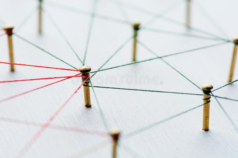 Background. Abstract concept idea of network, social media, internet, teamwork, communication. Thumbtacks linked. Together by red thread. Isolated. Entities stock images