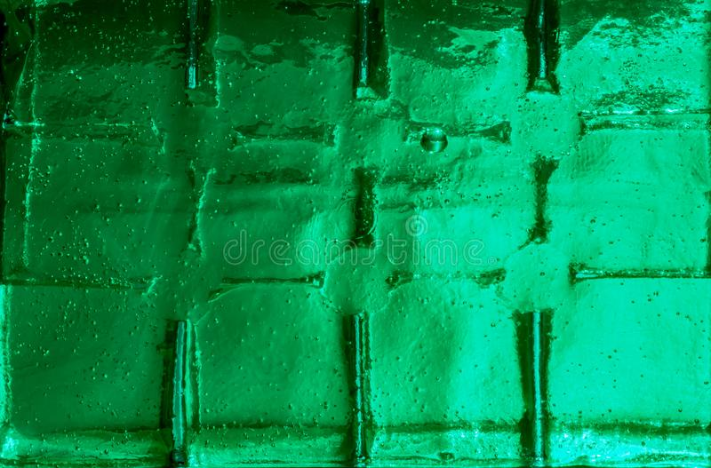 A cool and watery textured green grid abstract abstract background. A cool, green, watery abstract and textured background stock photos