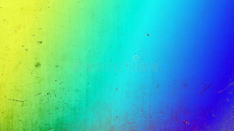 Abstract background. Colorful grunge textured background with a yellow to blue toned gradient. royalty free stock photo
