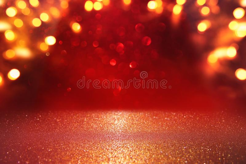 background of abstract red, gold and black glitter lights. defocused stock images