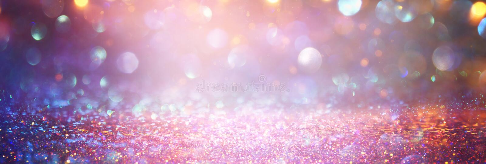 Background of abstract red, gold and purple glitter lights. defocused.  stock images
