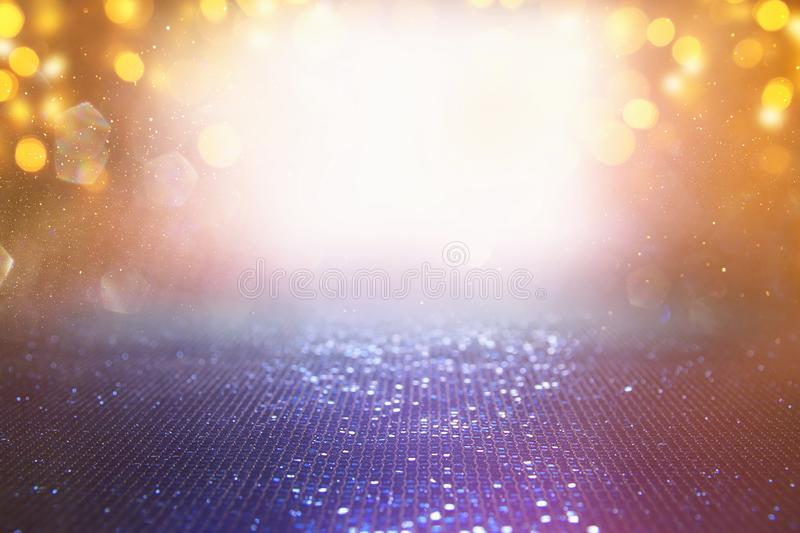 Background of abstract red, gold and purple glitter lights. defocused.  stock photography
