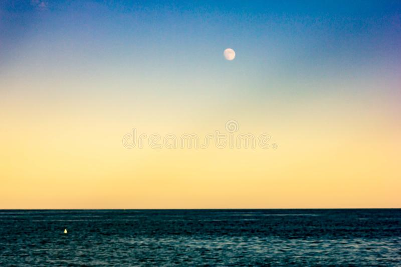 Background. abstract. seascape with colored sky and moon. ideal for wallpapers.  stock image