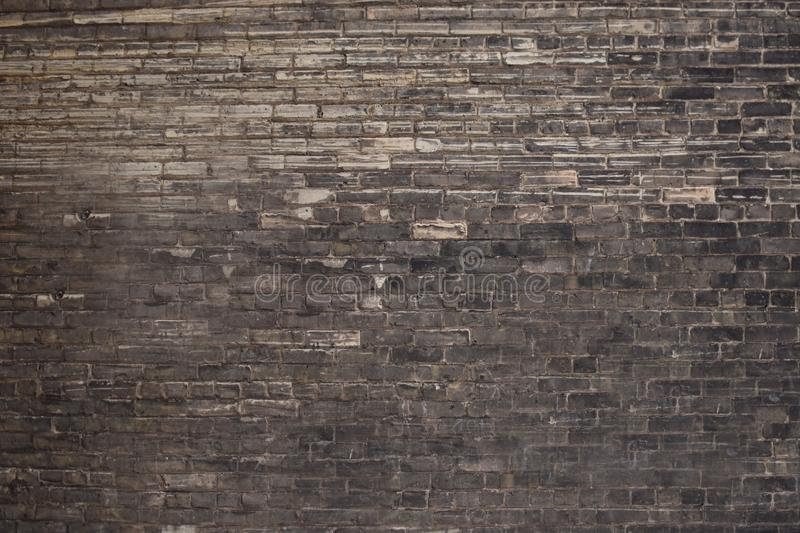 Background abstraction brick wall with black and gray bricks stock image