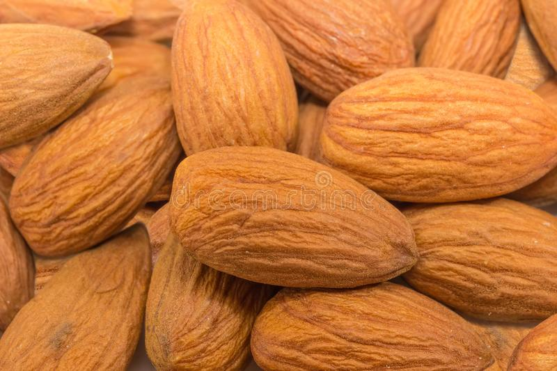 Background of the almonds peeled from shells closeup royalty free stock images
