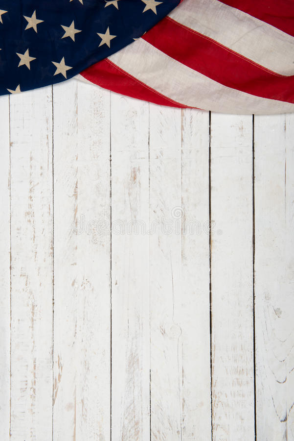 Background with an American flag. White wooden background with an American flag royalty free stock image