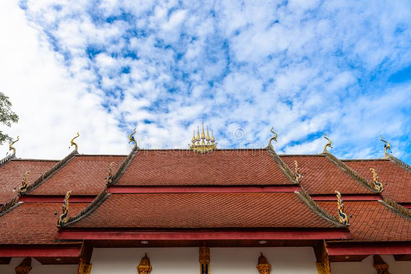 Thai Temple roof with blue sky. Background of The ancient Thai Temple roof with blue sky stock image