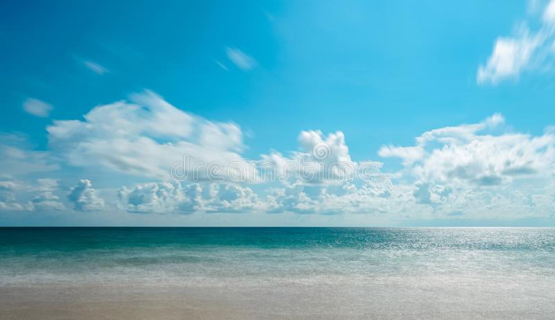 Background of Andaman sea, sand, beach with blue sky, white cloud and copy space in summer at  Phuket Thailand. Background of Andaman sea, sand, beach with blue royalty free stock image