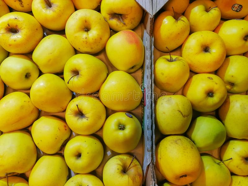 A background of Apples in a drawer. Yellow apple Raw fruit and vegetable organic fresh produce royalty free stock photos
