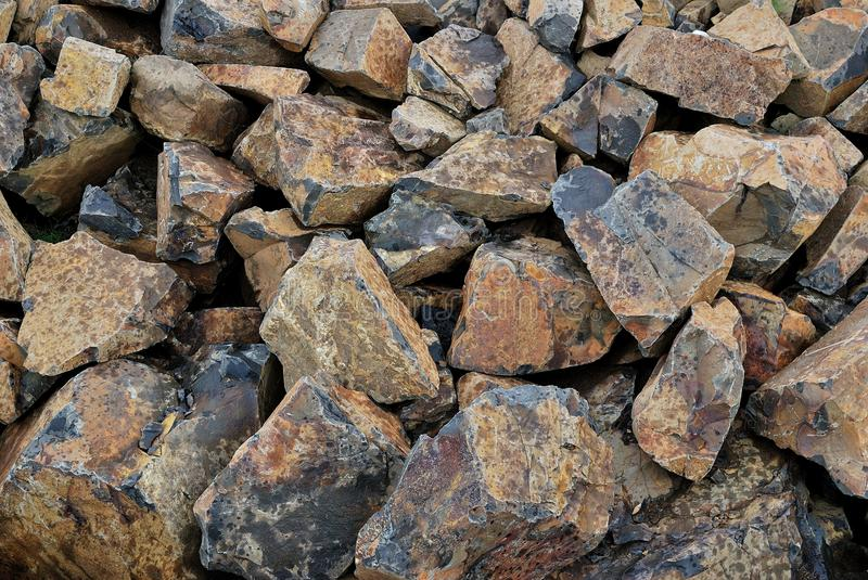Background as a pile of burned stones royalty free stock photo