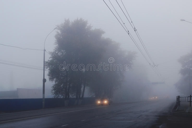 Background autumn fog on city road royalty free stock images