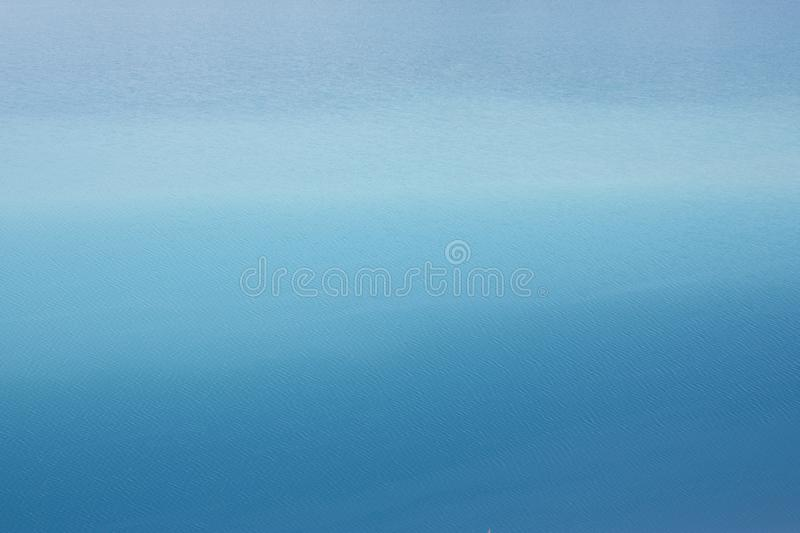 Background azure blue expanse of the sea with small ripples on the water stock photo