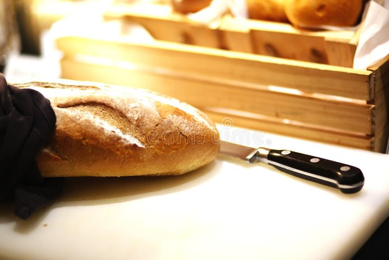 French loaf on breadboard stock photography