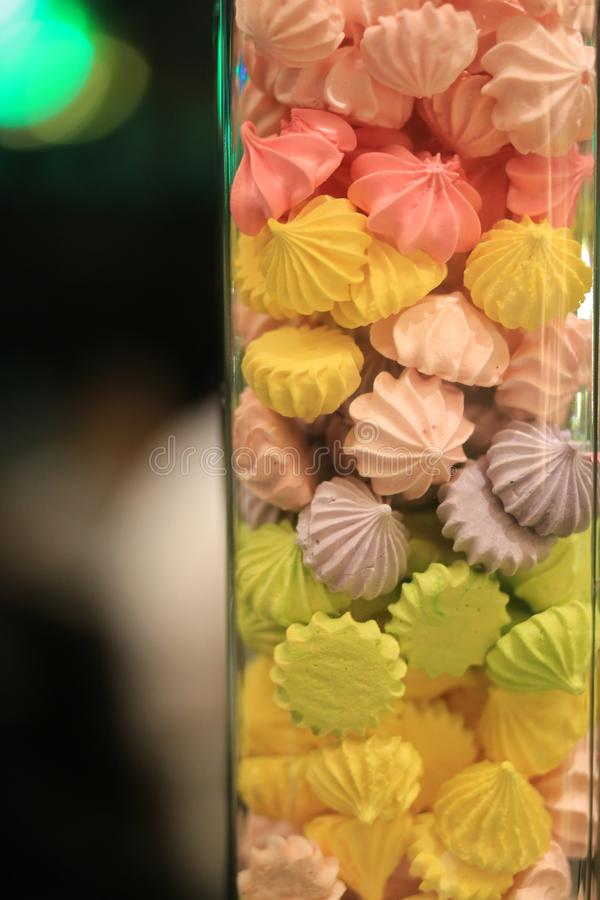 Colorful meringue in glass with copy space blurred background royalty free stock photos