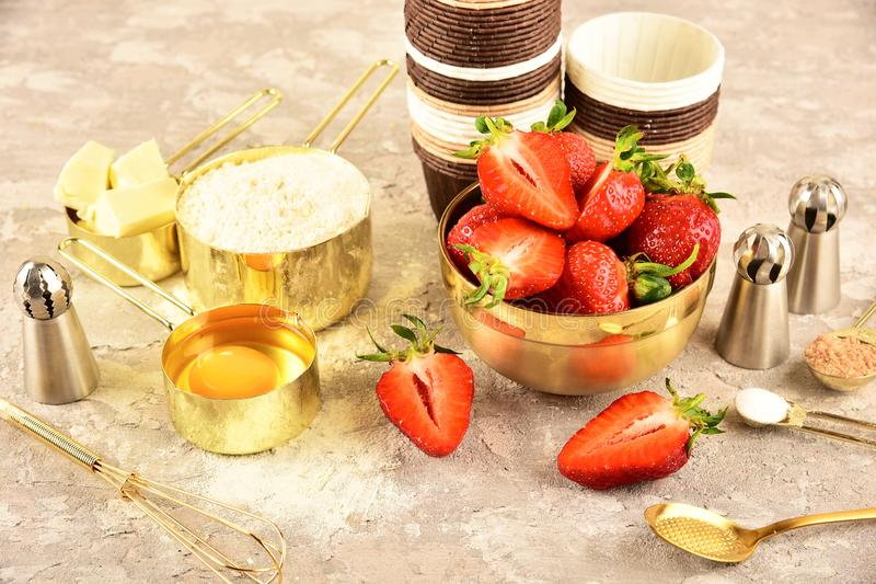 Background baking flat lay with golden devices, strawberries and flour. Background baking flat lay with golden devices, strawberries and flour royalty free stock photo