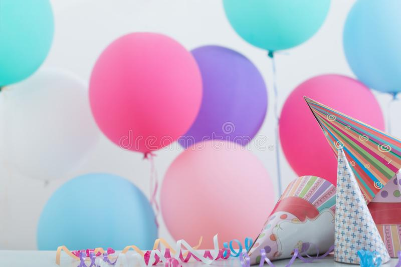 Background of balloons for birthday. Background of balloons and hats for birthday stock image