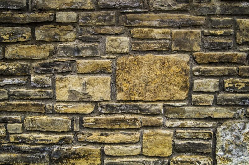 Background of beautiful structural masonry stones stock photography