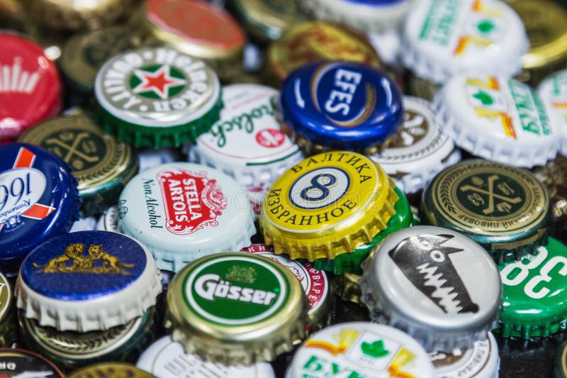 Background of beer bottle caps, a mix of various global brands royalty free stock photography