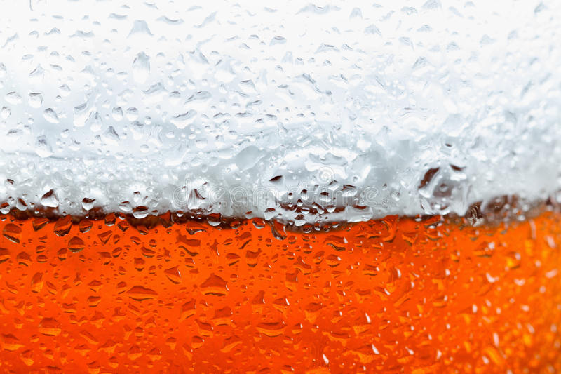 Background beer with foam and bubbles. Macro stock image
