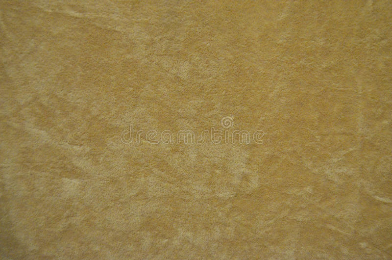 Background from a beige perfect suede fabric. royalty free stock image